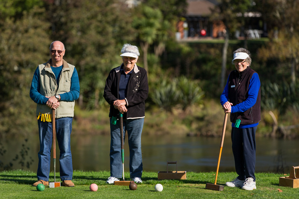 Retirees playing golf - retirement activity