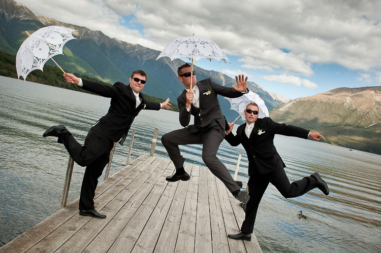 wedding photo groomsmen groom bridal party nelson nz jump nelson lakes lake rotoiti