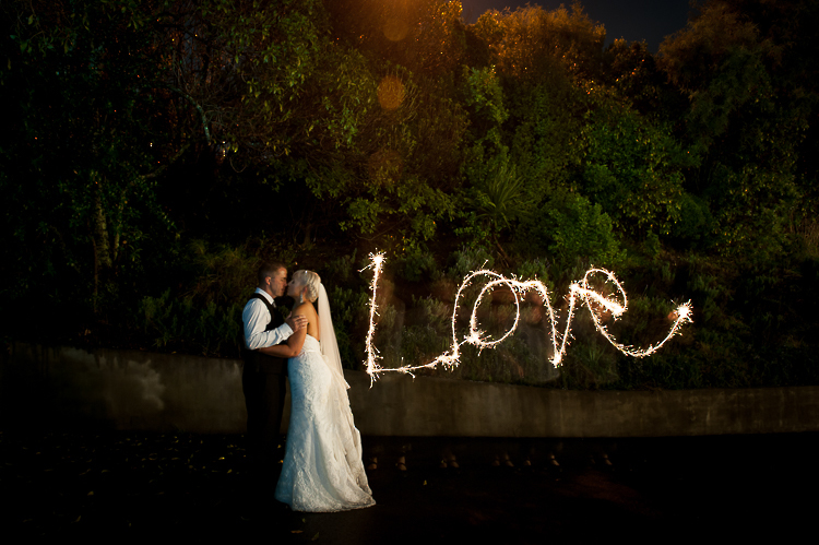 bride and groom love wedding nelson nz reception sandra johnson boutique photography night sparkler
