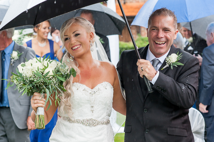 monaco grand_mecure_nelson rain happy wedding ceremony bride groom wedding party sandra johnson boutique photography marlborough nz