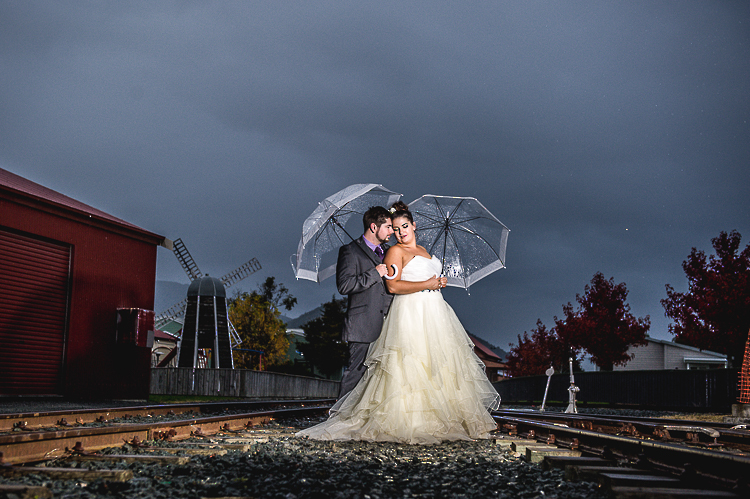 bride and groom love wedding nelson nz reception sandra johnson boutique photography founders park rain