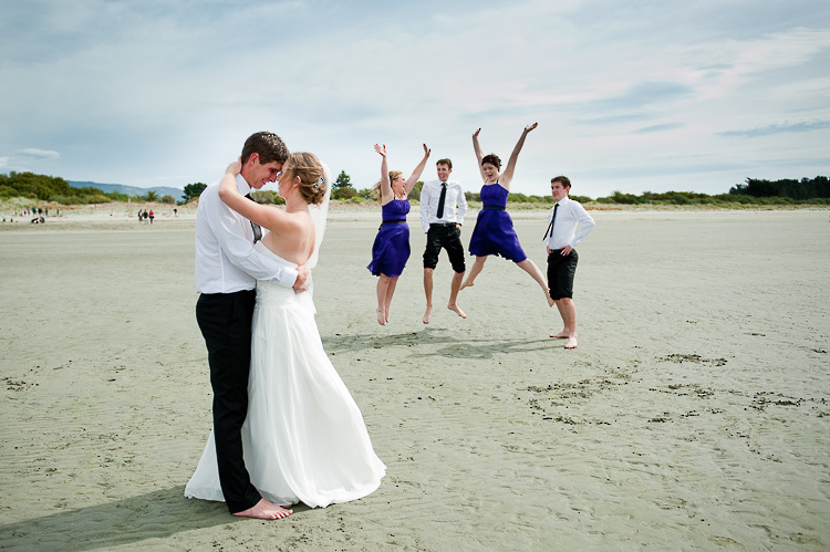 bride bridesmaids bridal party nelson nz wedding photos bridal party tahunanui beach jump