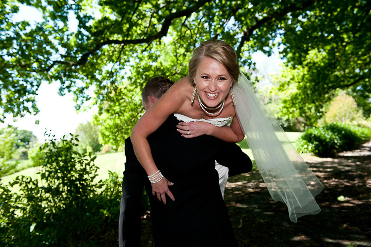 bride and groom love wedding romance glamour nelson nz carrying