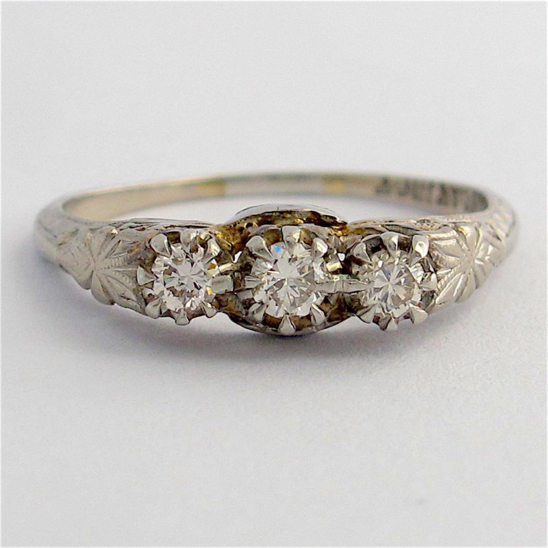 18ct white gold and platinum vintage three stone diamond set ring image 0