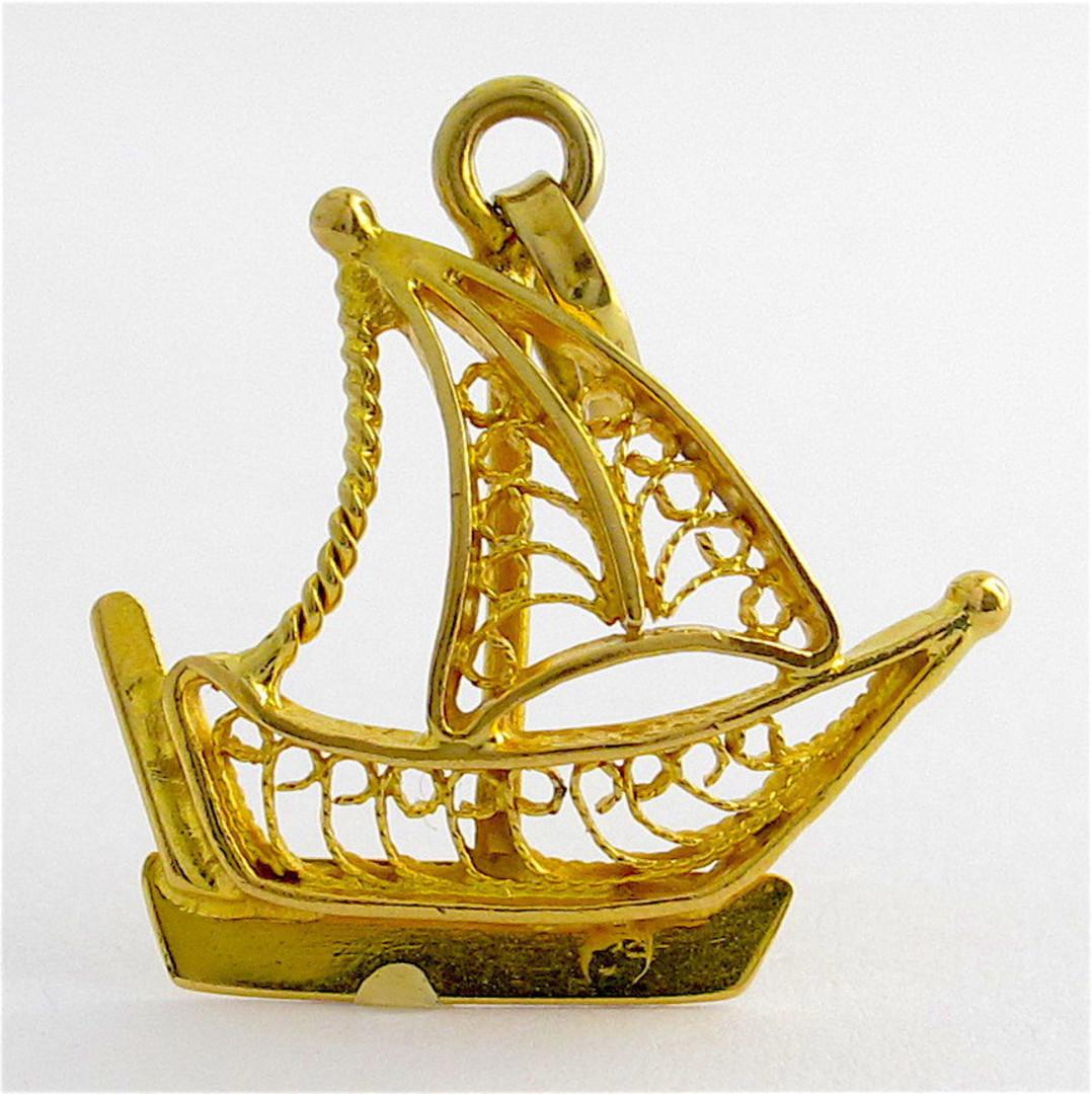 21ct yellow gold filigree sailing boat charm image 0