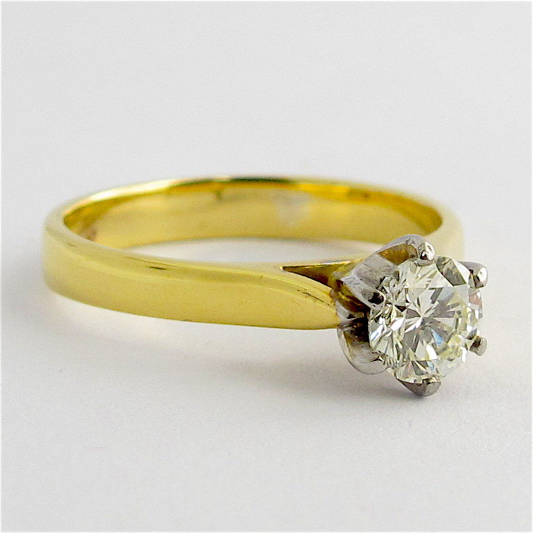 18ct yellow and white gold diamond solitaire ring image 1
