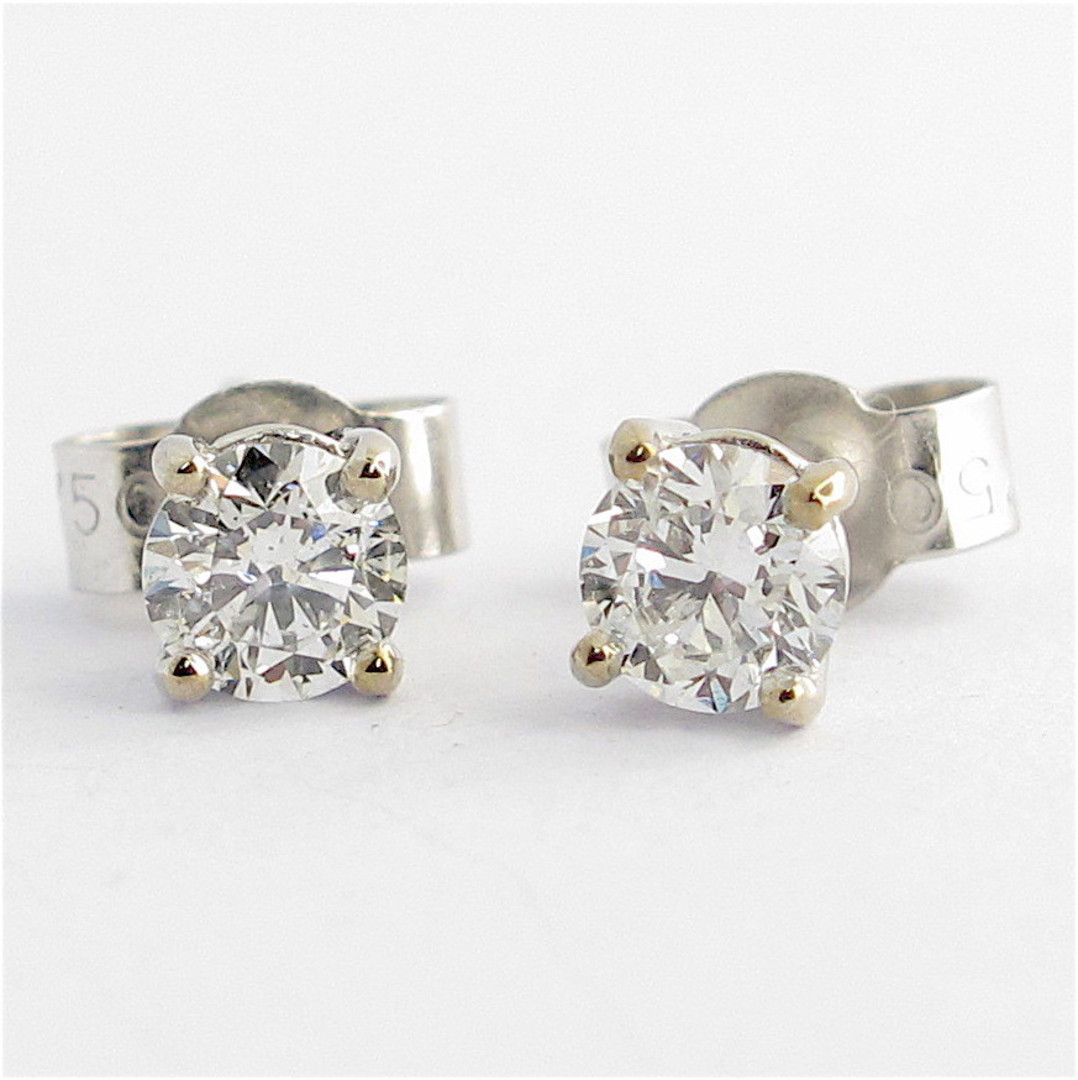 18ct white gold 0.54ct TDW diamond solitaire stud earrings image 1