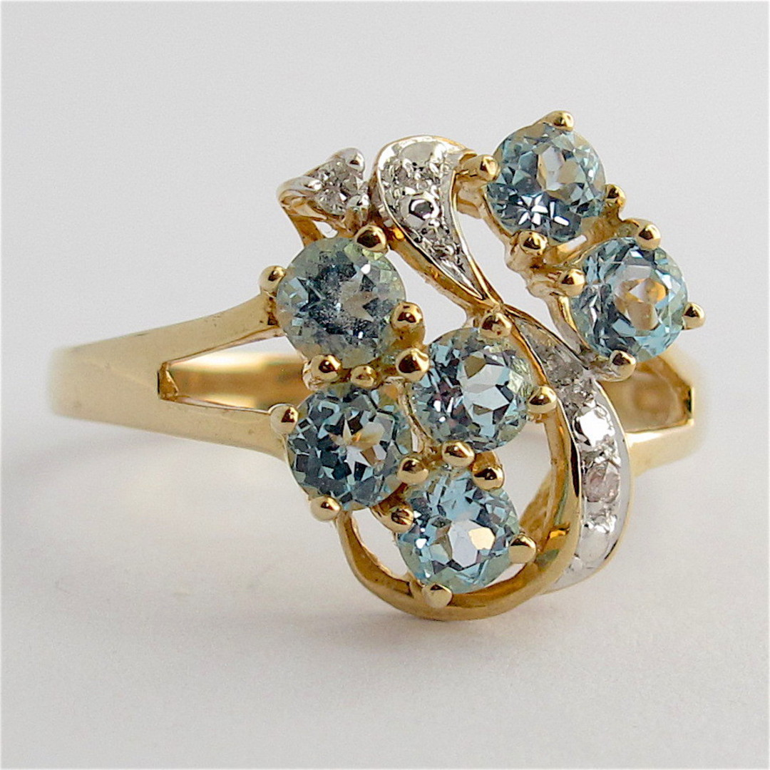 9ct yellow and white gold blue topaz and diamond set cluster ring image 0