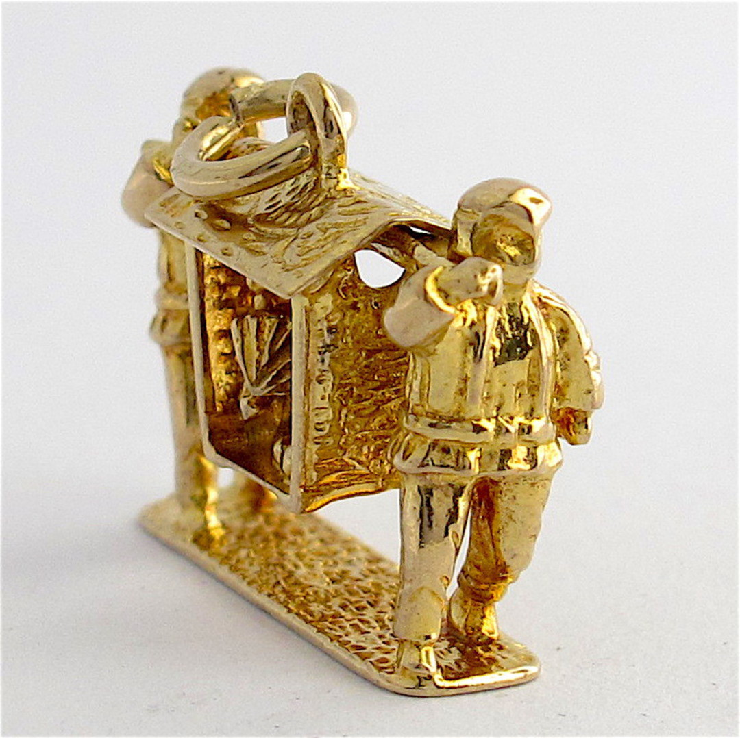 9ct yellow gold Chinese sedan chair with woman being carried charm image 1