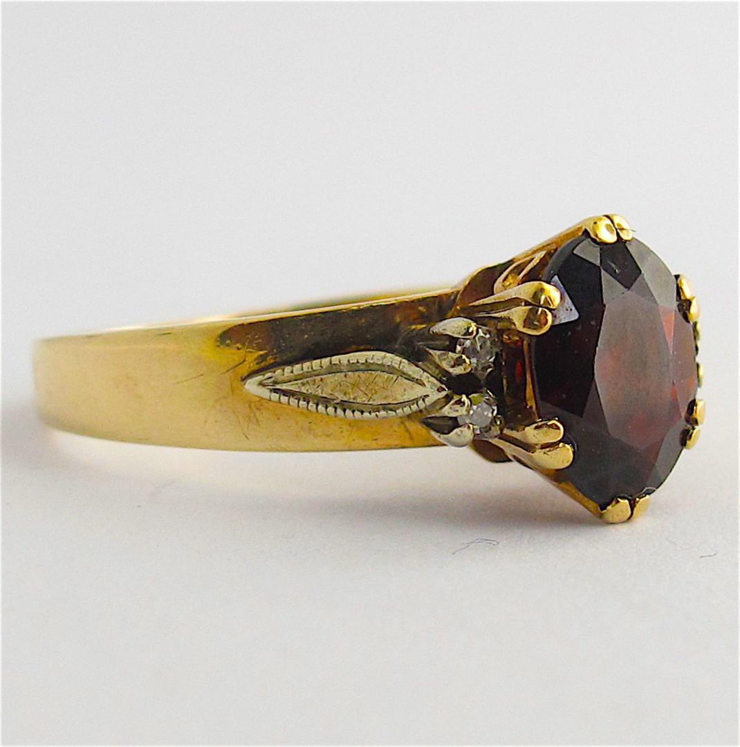 9ct yellow gold garnet and diamond set ring image 1