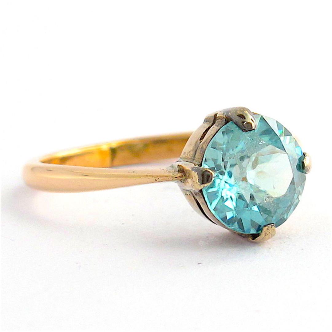 9ct rose gold blue zircon ring image 1