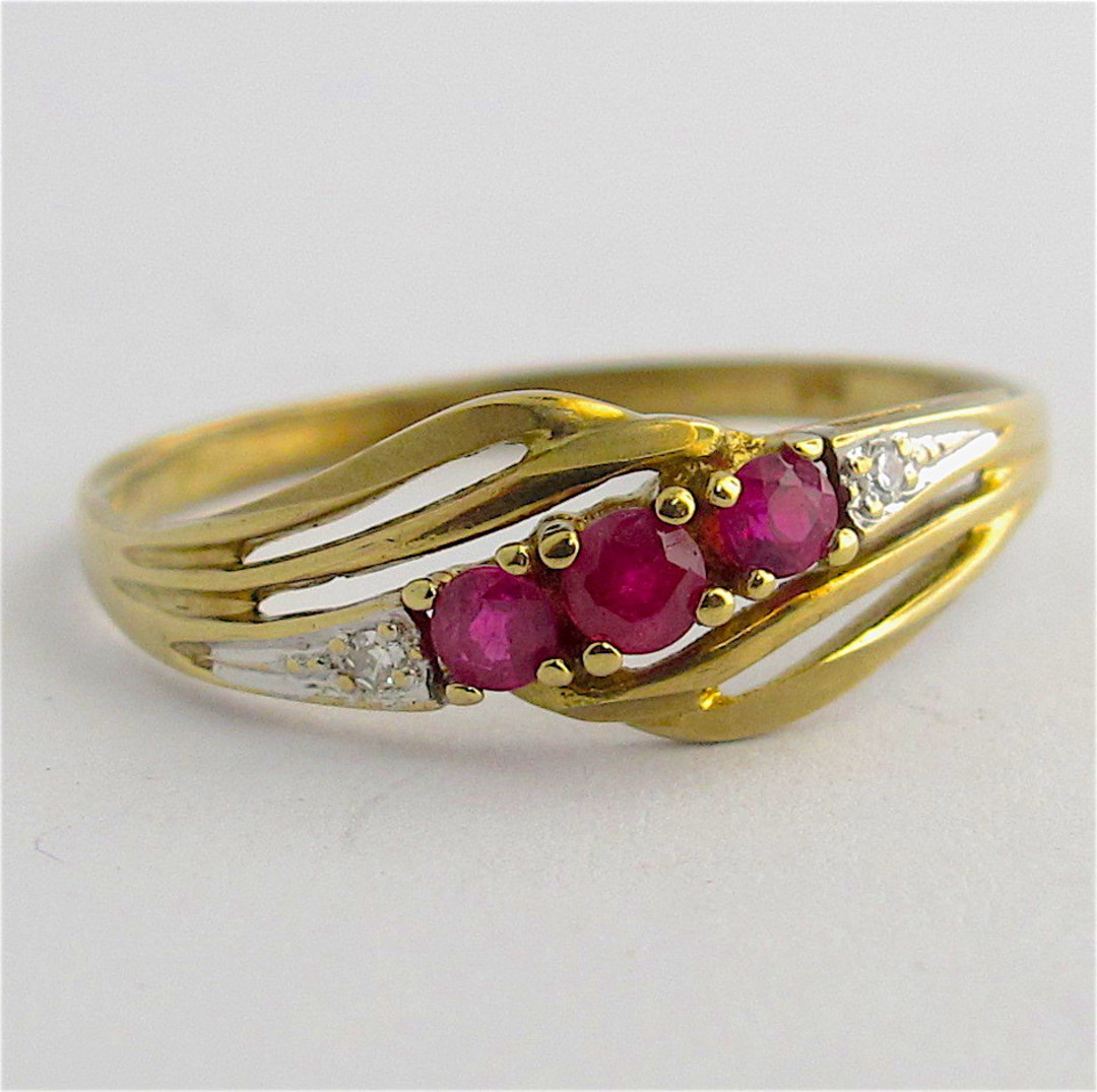 9ct yellow & white gold natural ruby and diamond set ring image 0