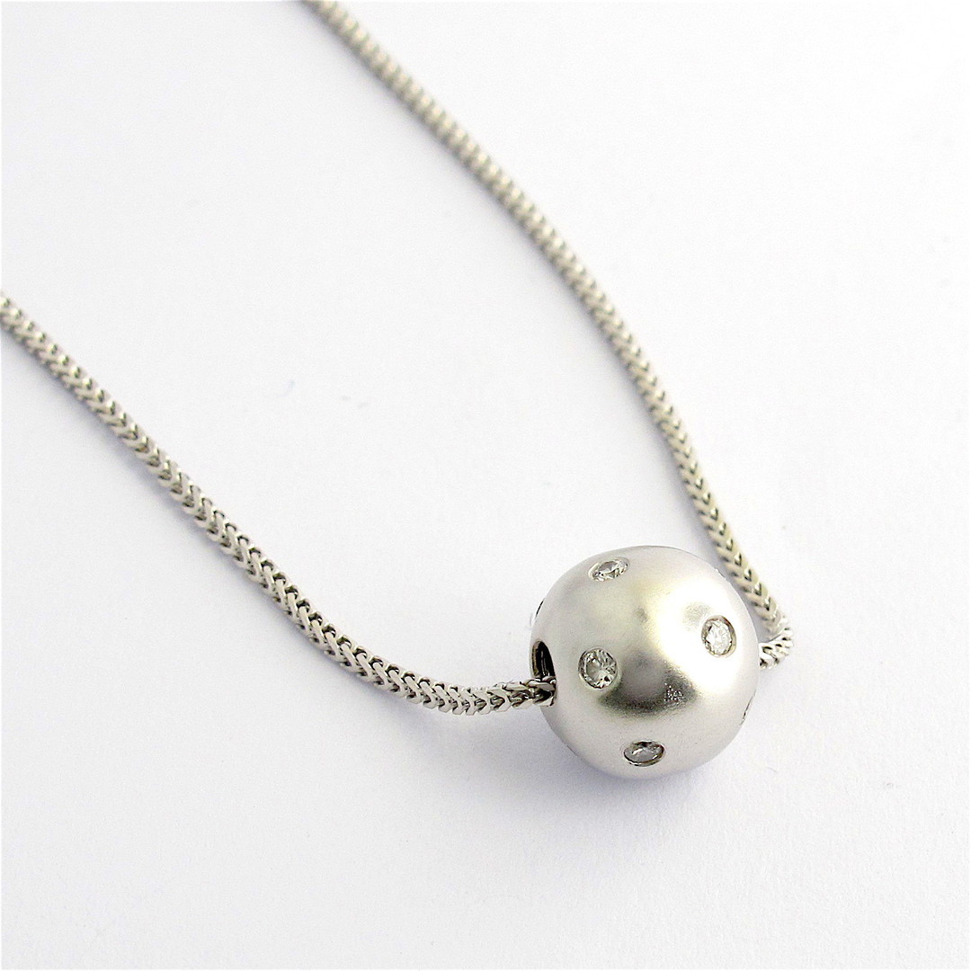 18ct white gold diamond ball pendant and chain image 0