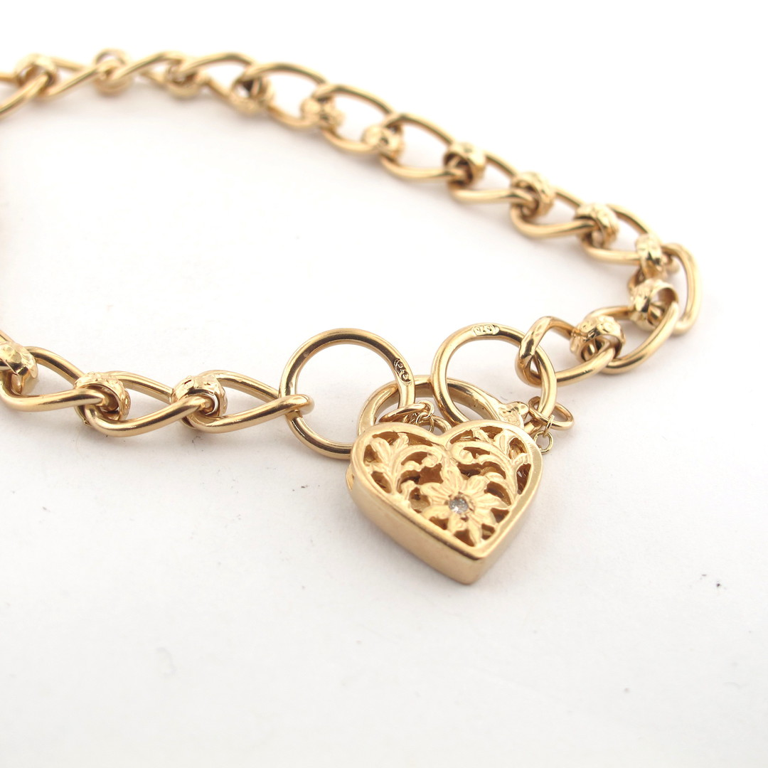 9ct yellow gold oval link bracelet with a heart padlock set with a diamond image 1