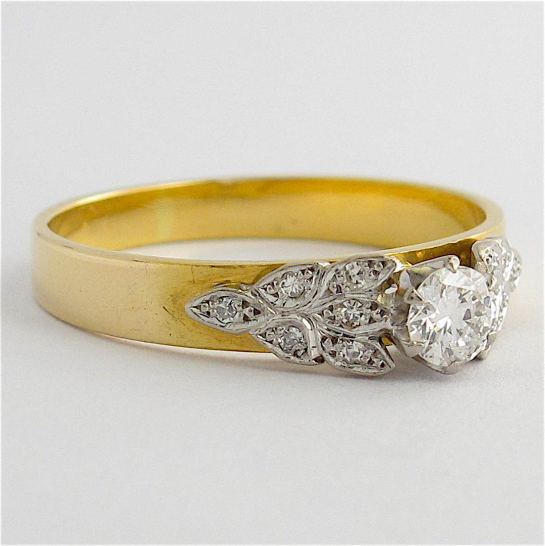 Vintage 18ct yellow and white gold diamond solitaire with fancy design image 1
