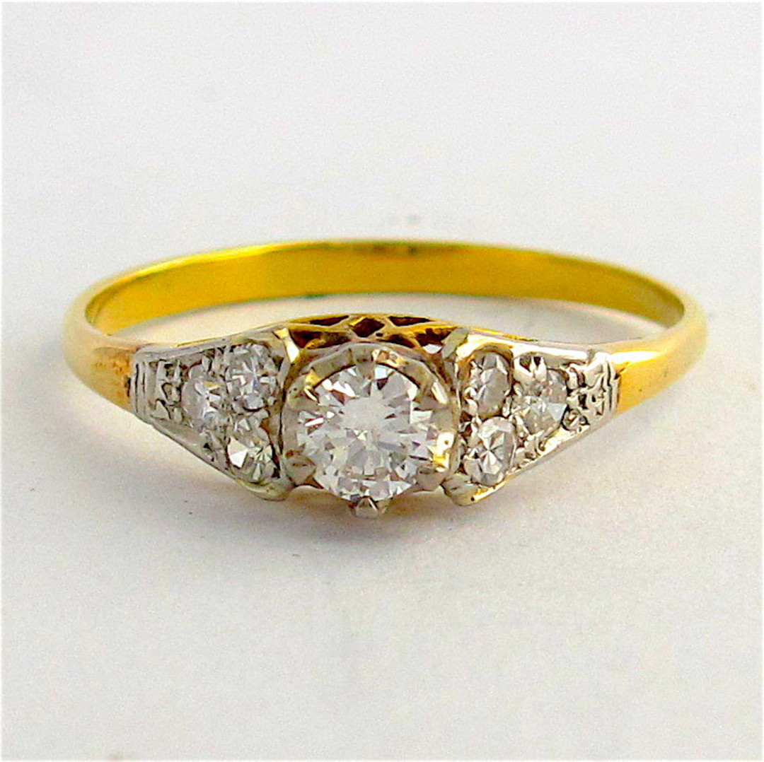 18ct yellow gold and platinum diamond solitaire ring with diamond set shoulders image 0