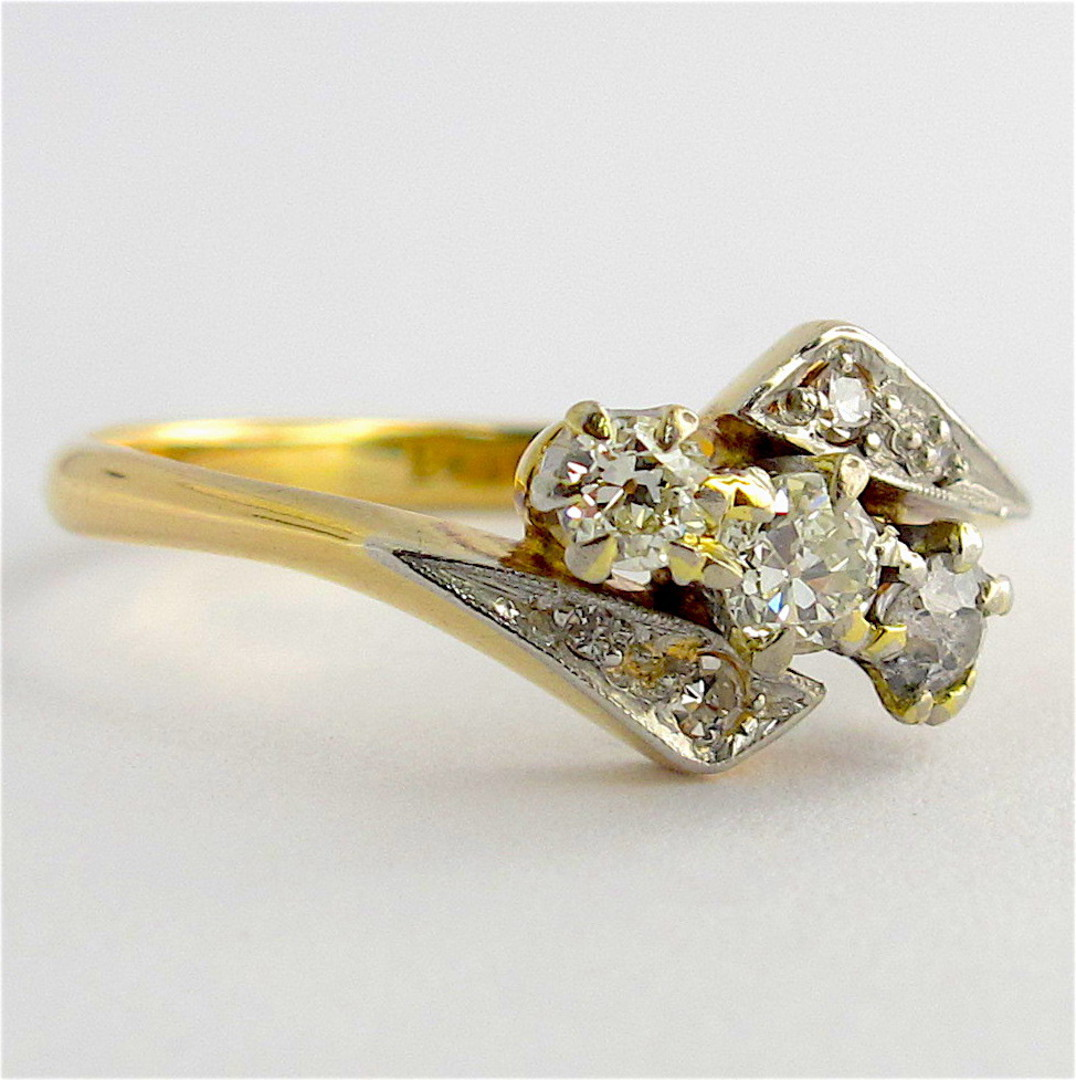 18ct yellow and white gold vintage three diamond set ring image 0