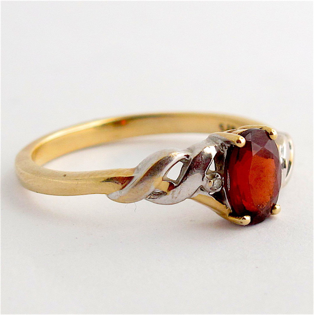 9ct yellow gold and rhodium plated garnet dress ring image 1