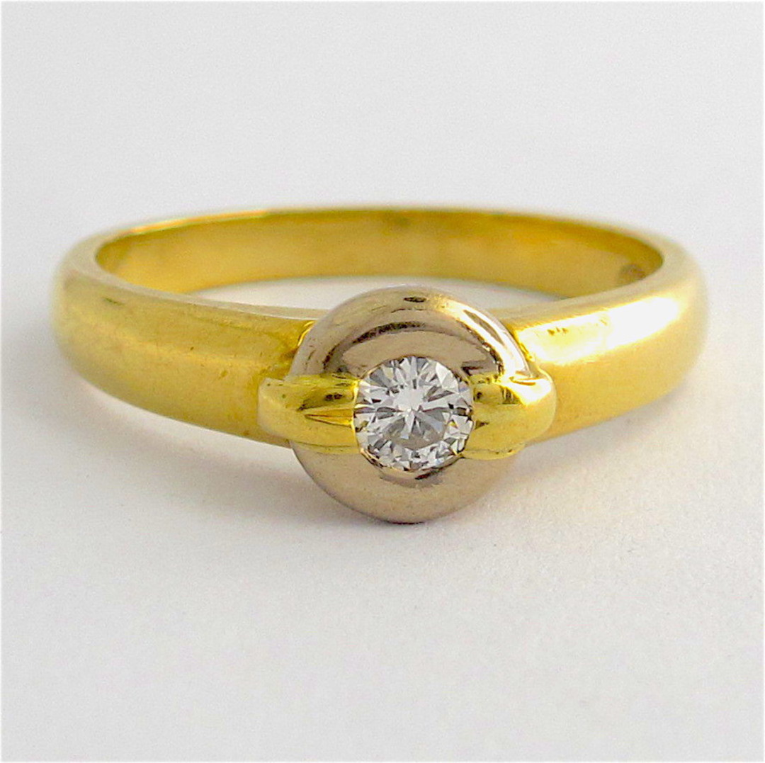 18ct yellow and white gold rub over set diamond ring image 0