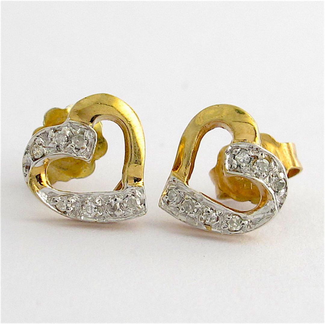 9ct yellow gold and rhodium plated heart shape diamond stud earrings image 0
