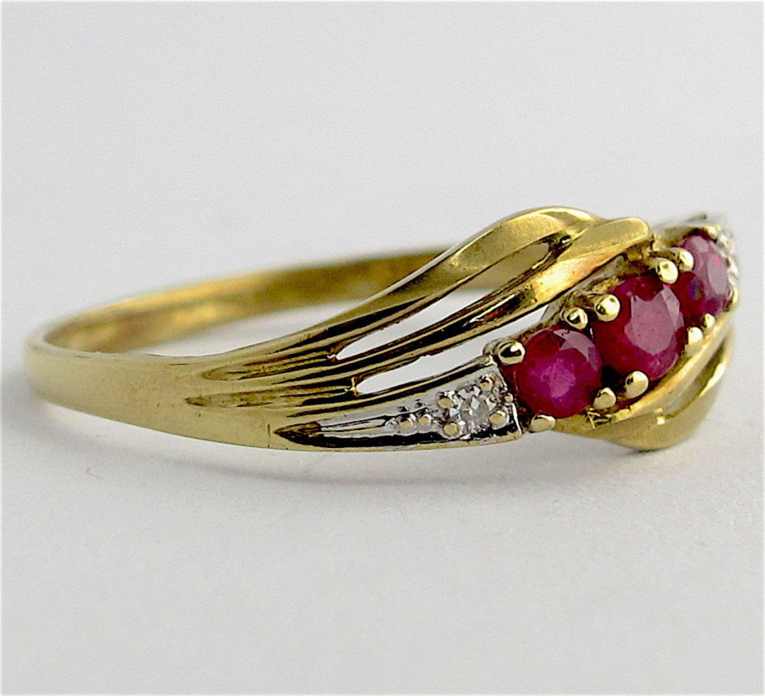 9ct yellow & white gold natural ruby and diamond set ring image 1