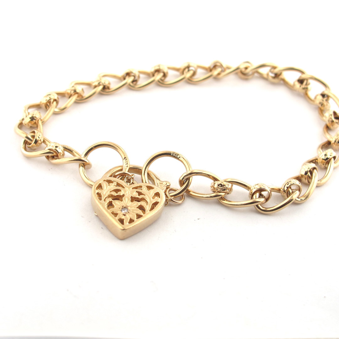 9ct yellow gold oval link bracelet with a heart padlock set with a diamond image 0
