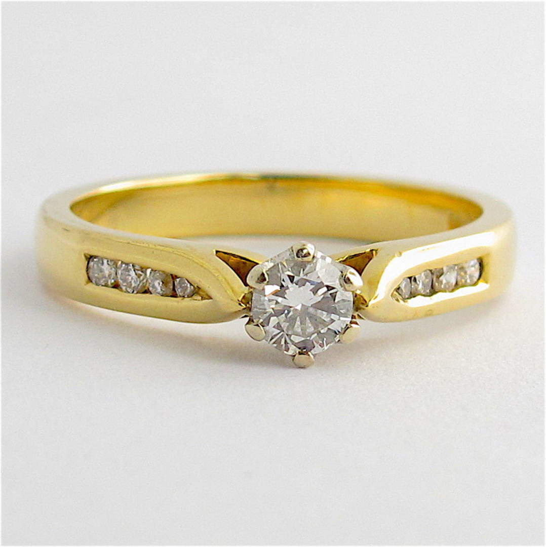 18ct yellow and white gold diamond solitaire with shoulder diamond set ring image 0