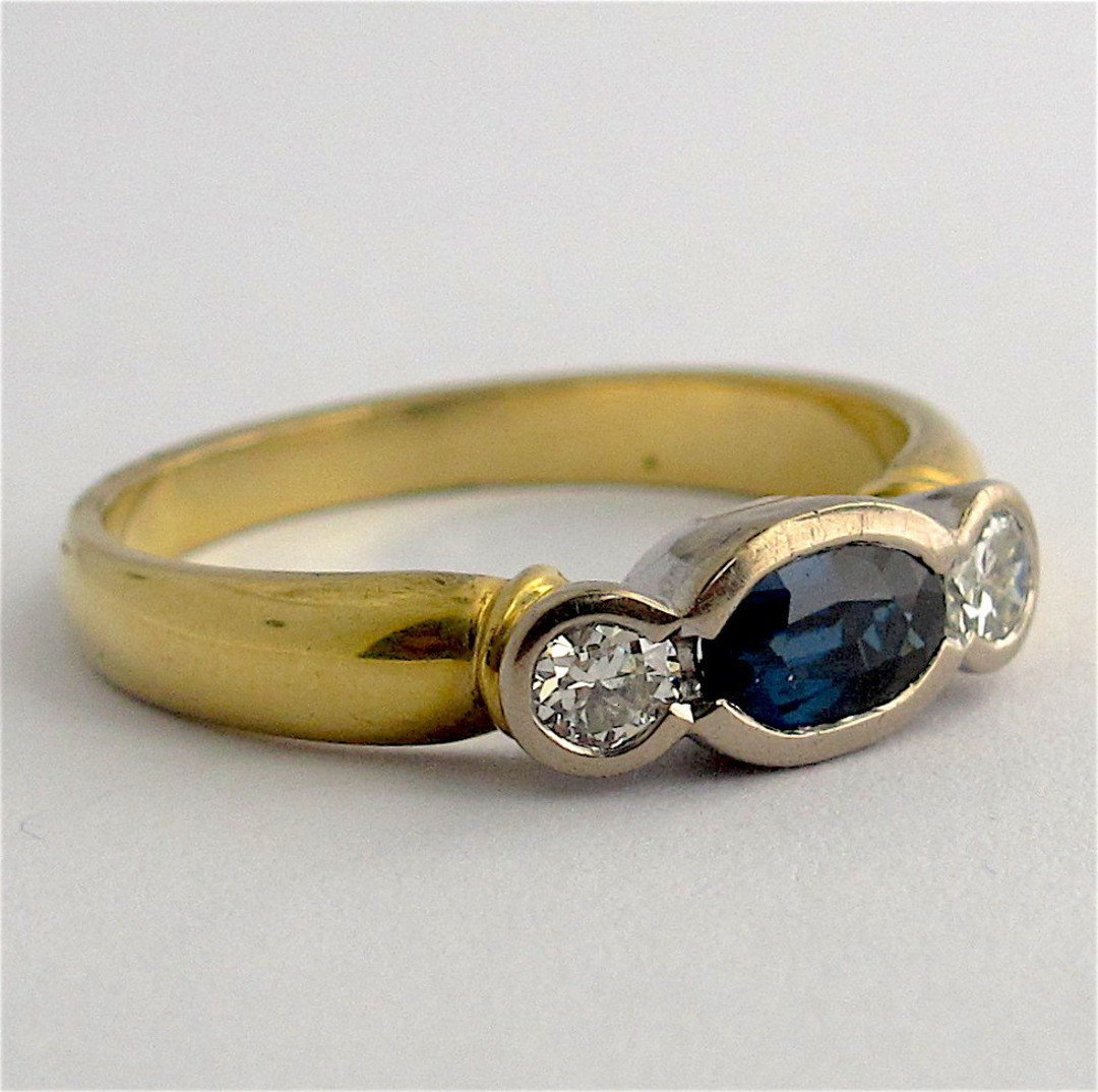 18ct yellow and white gold sapphire and diamond rub over style ring image 1
