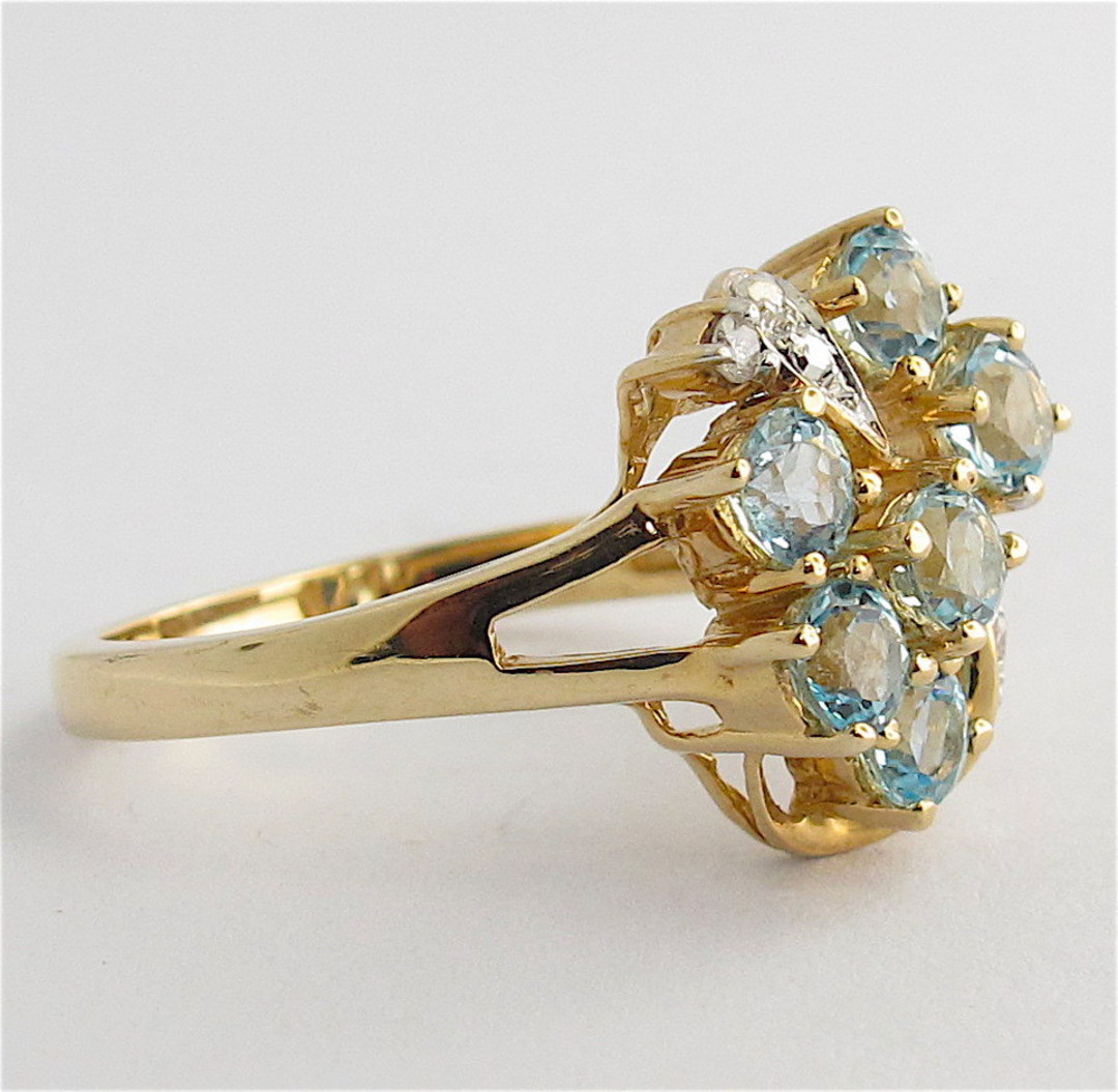 9ct yellow and white gold blue topaz and diamond set cluster ring image 1