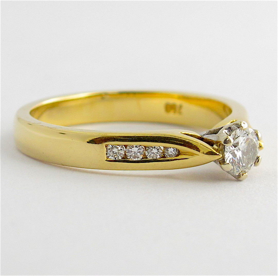 18ct yellow and white gold diamond solitaire with shoulder diamond set ring image 1