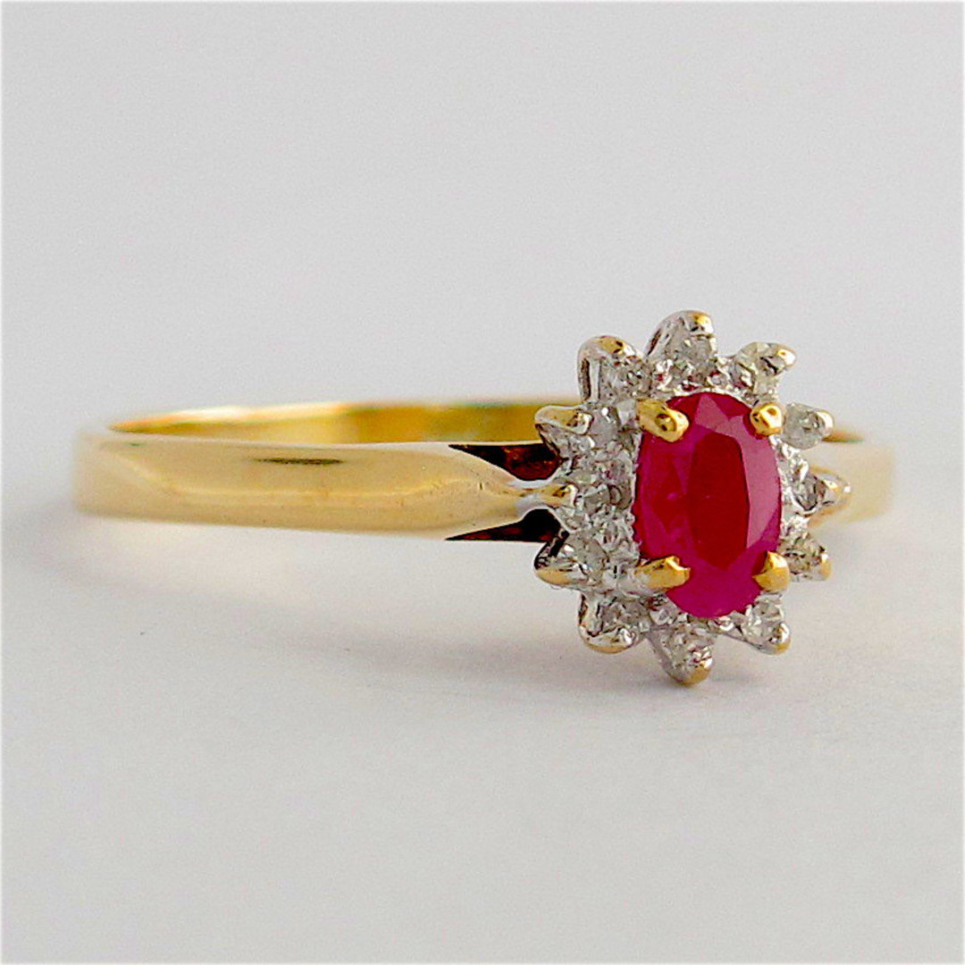 9ct yellow and white gold ruby and diamond cluster ring image 0