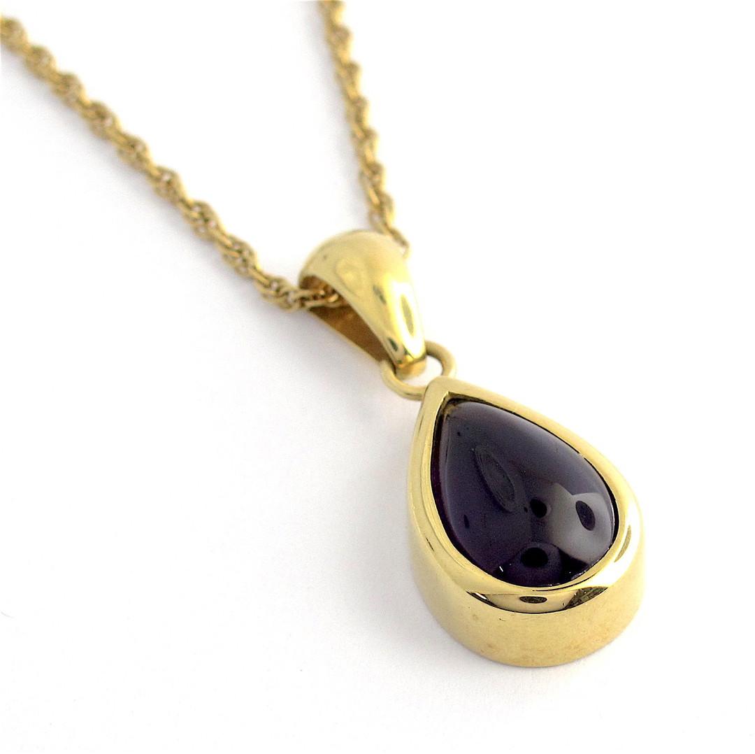 18ct yellow gold British hallmarked teardrop shape cabochon amethyst pendant and chain image 0