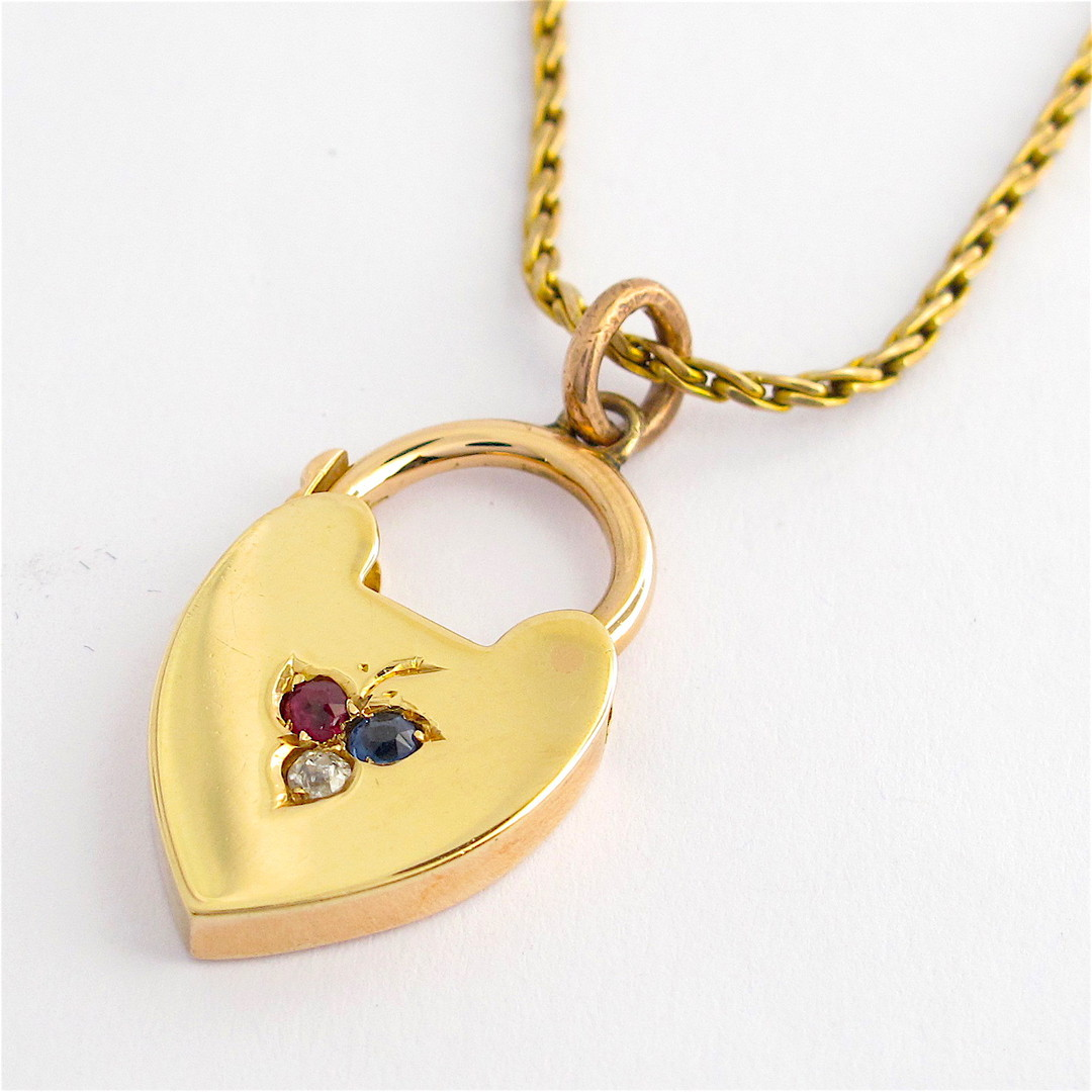 15ct yellow over rose gold vintage gem set heart pendant and yellow gold charm image 0