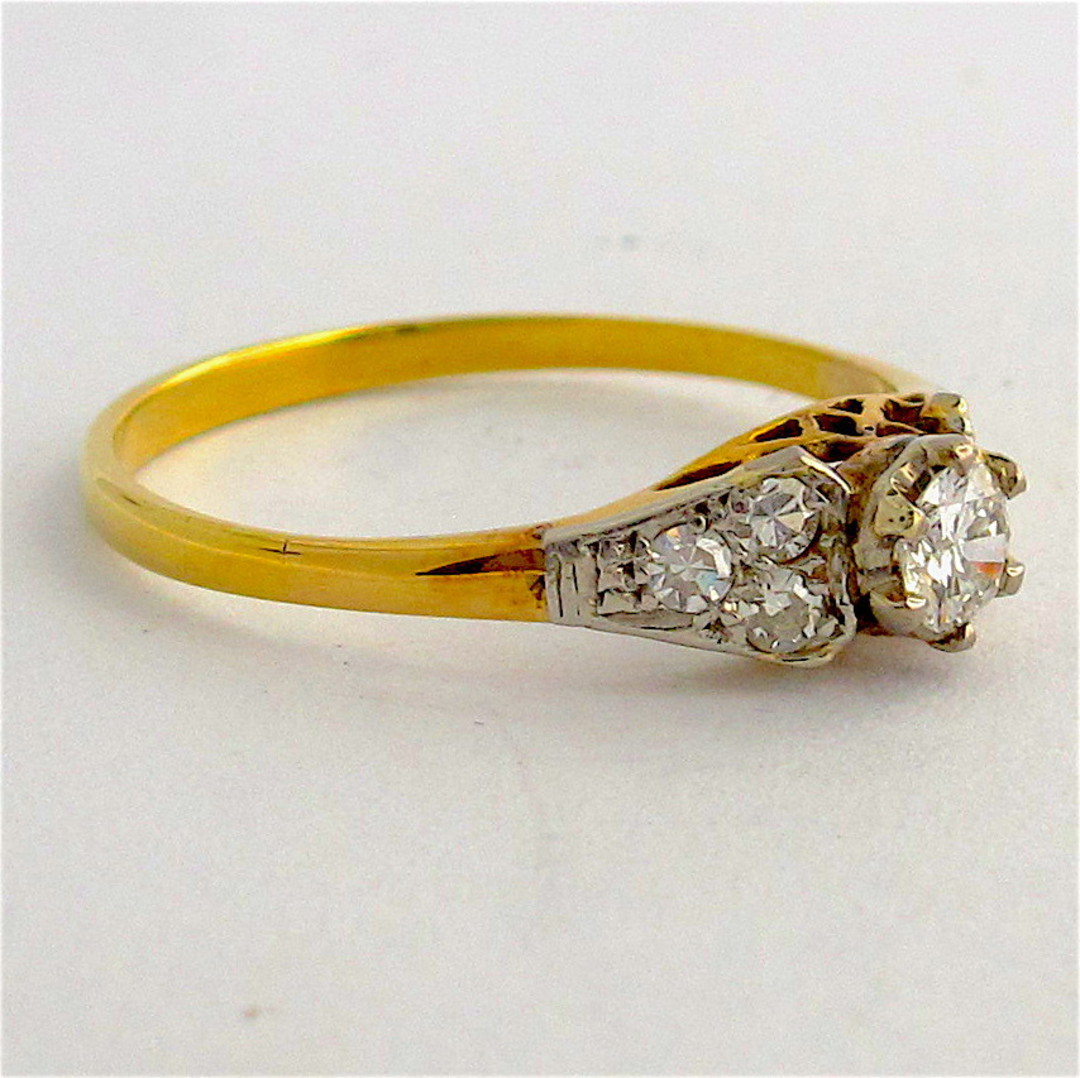 18ct yellow gold and platinum diamond solitaire ring with diamond set shoulders image 1
