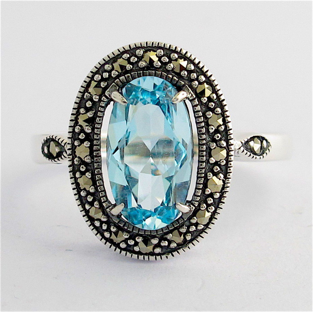Sterling silver blue topaz and marcasite dress ring image 0