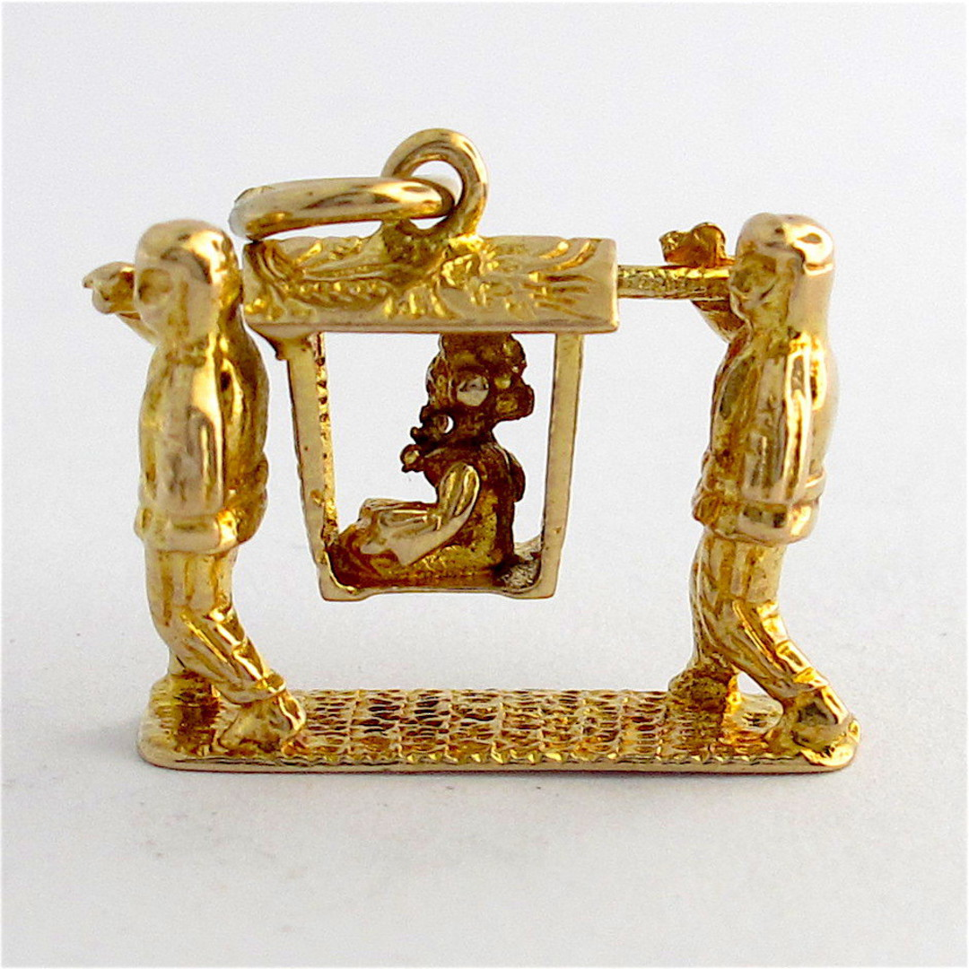 9ct yellow gold Chinese sedan chair with woman being carried charm image 0