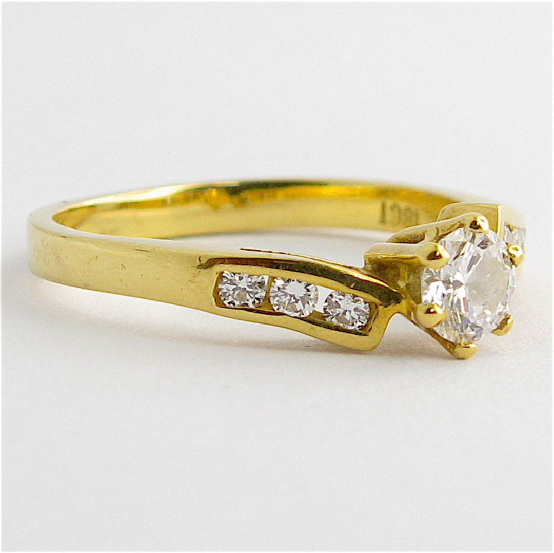 18ct yellow gold diamond solitaire with shoulder diamonds set ring image 1
