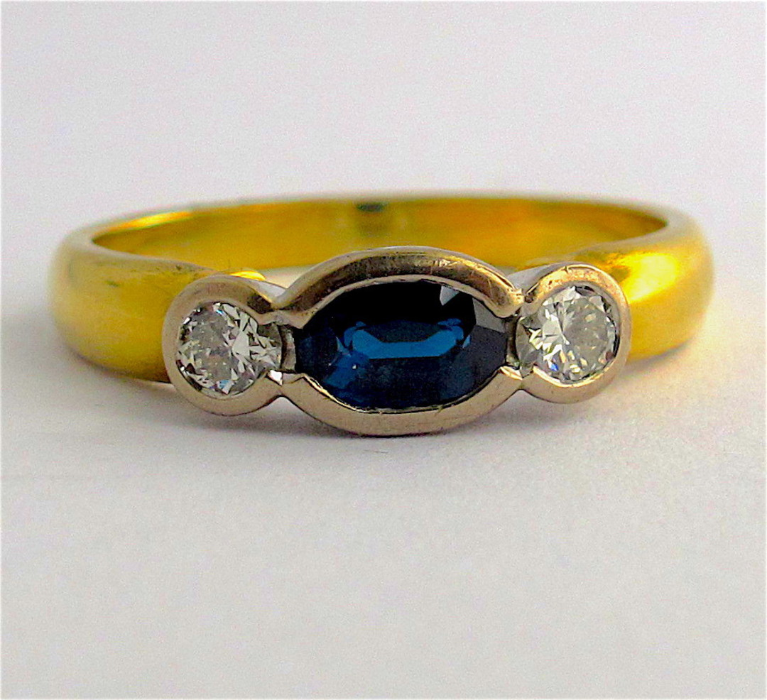 18ct yellow and white gold sapphire and diamond rub over style ring image 0
