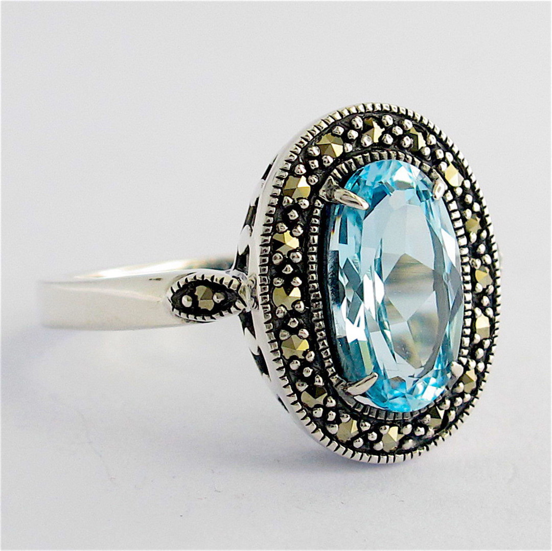 Sterling silver blue topaz and marcasite dress ring image 1