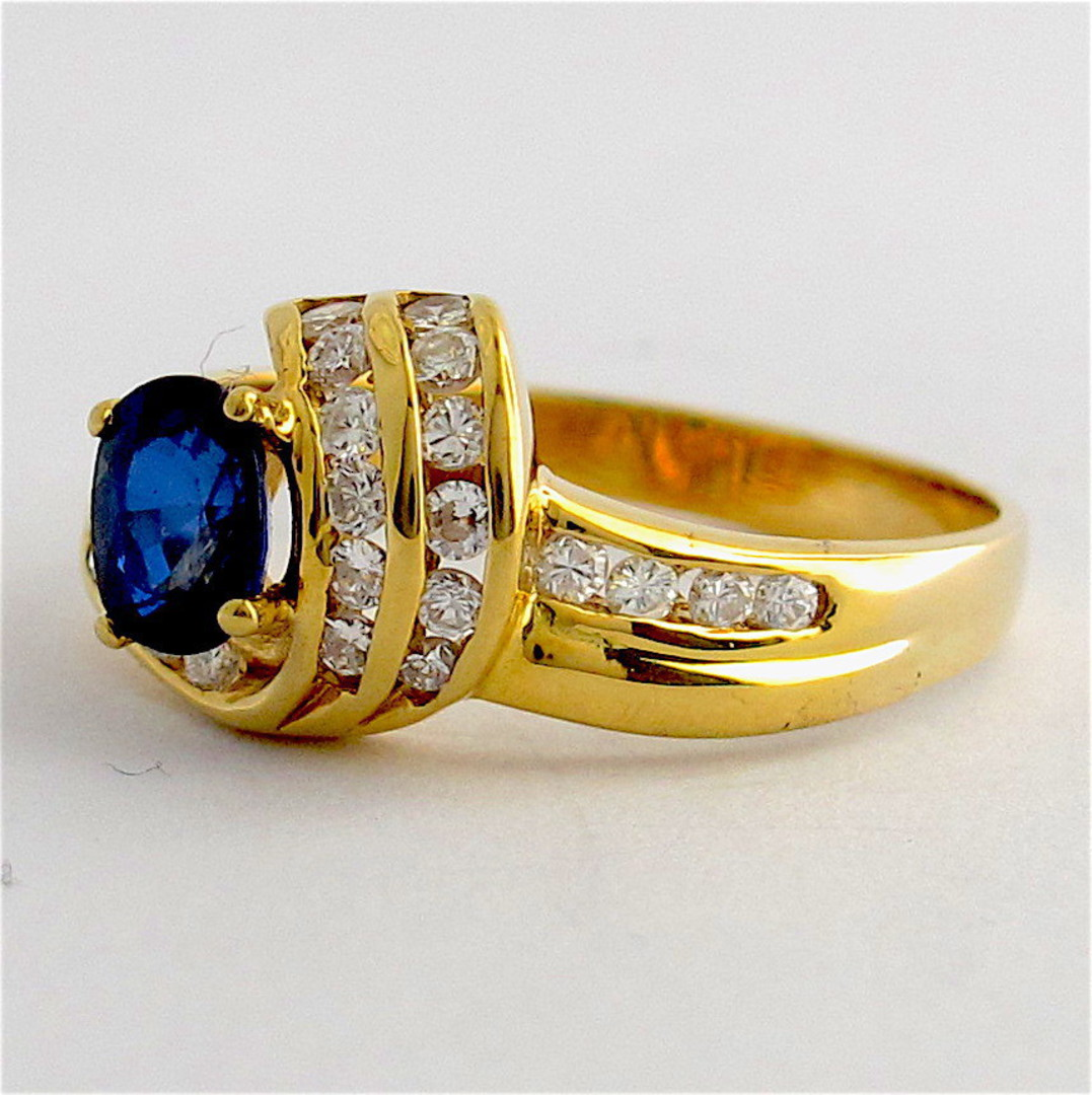 18ct yellow gold diamond and sapphire ring image 1