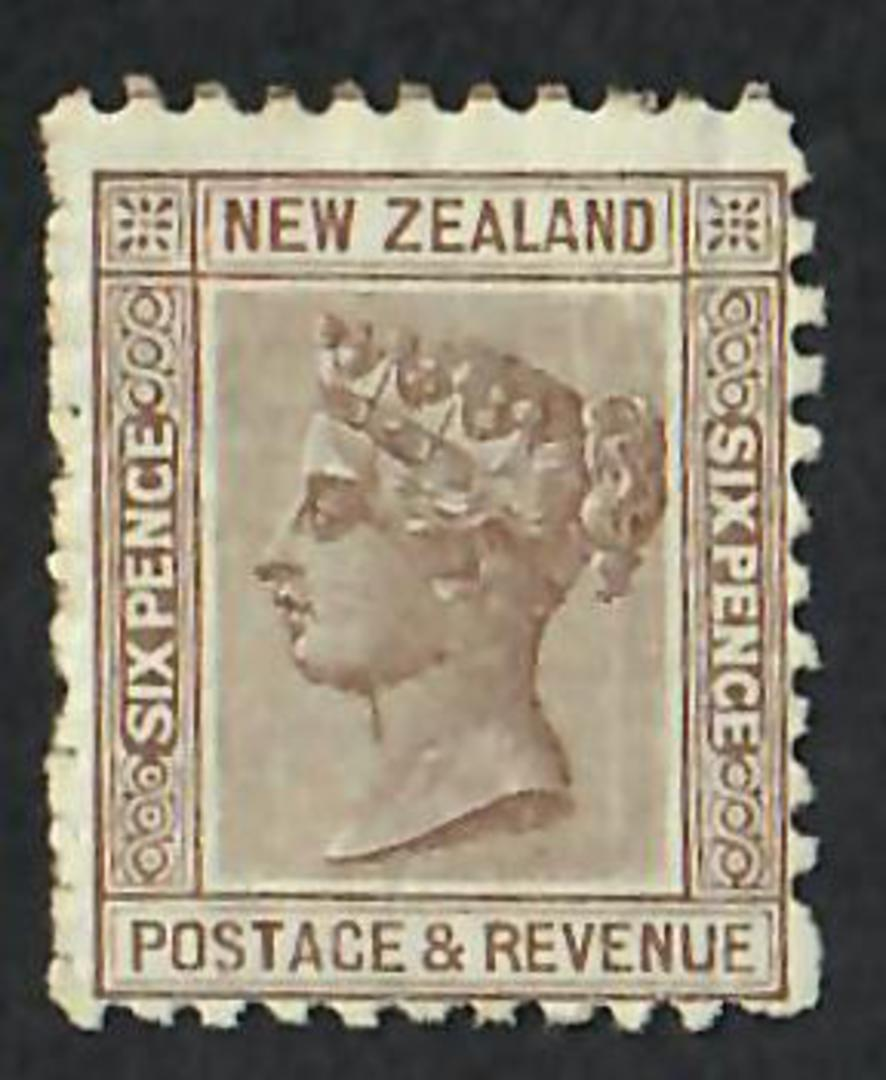 NEW ZEALAND 1882 Victoria 1st Second Sideface 6d Brown. Perf 11. The perfs down one side are not punched out But they are all th image 0