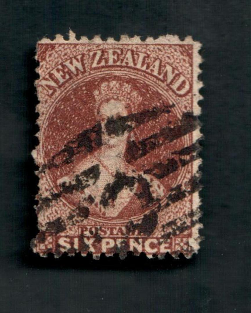 NEW ZEALAND 1862 Full Face Queen 6d Brown. Heavy postmark C. - 39242 - Used image 0