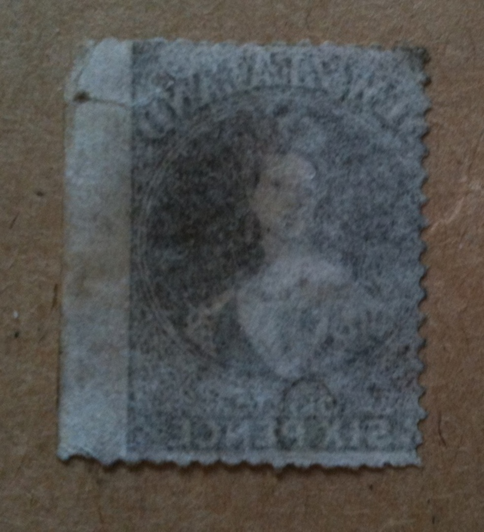 NEW ZEALAND 1862 Full Face Queen 6d Black-Brown. Pelure paper. Perf 13 at Dunedin. Superb copy with clear perfs on 3 sides and image 1