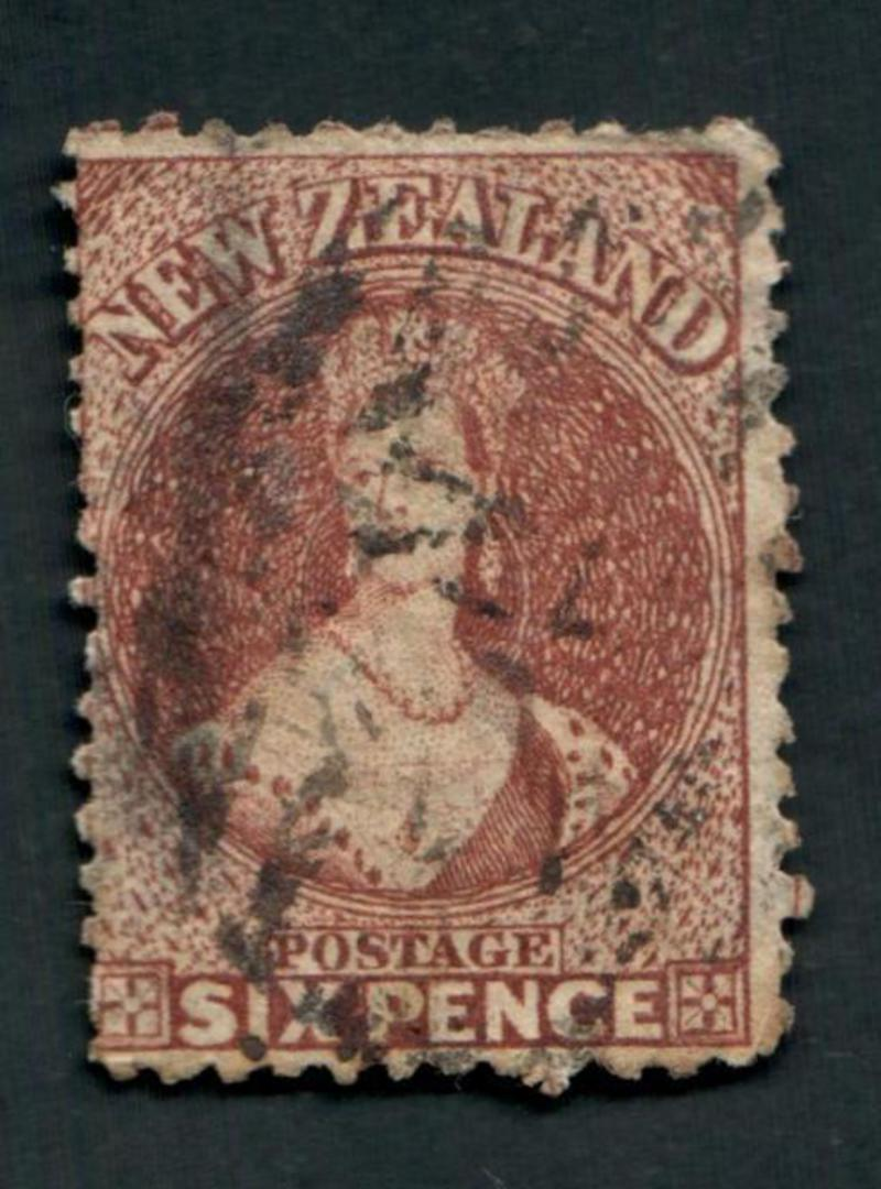 NEW ZEALAND 1862 Full Face Queen 6d Brown. Spacefiller. Perfs okay. Not torn. The postmark is unattractive. Cat val by CP with f image 0