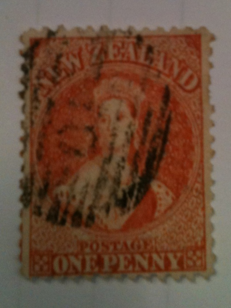 NEW ZEALAND 1862 Full Face Queen 1d Orange. Perforated. Light cancel that covers the face but the face is still clearly visible. image 0