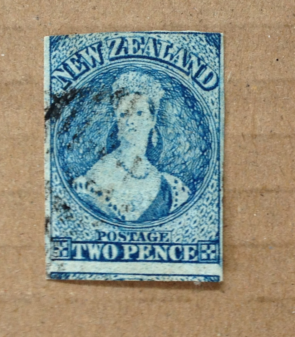 NEW ZEALAND 1855 Full Face Queen 2d Blue. Plate 1 showing early signs of wear. Three good margins touching along the top. Postma image 0