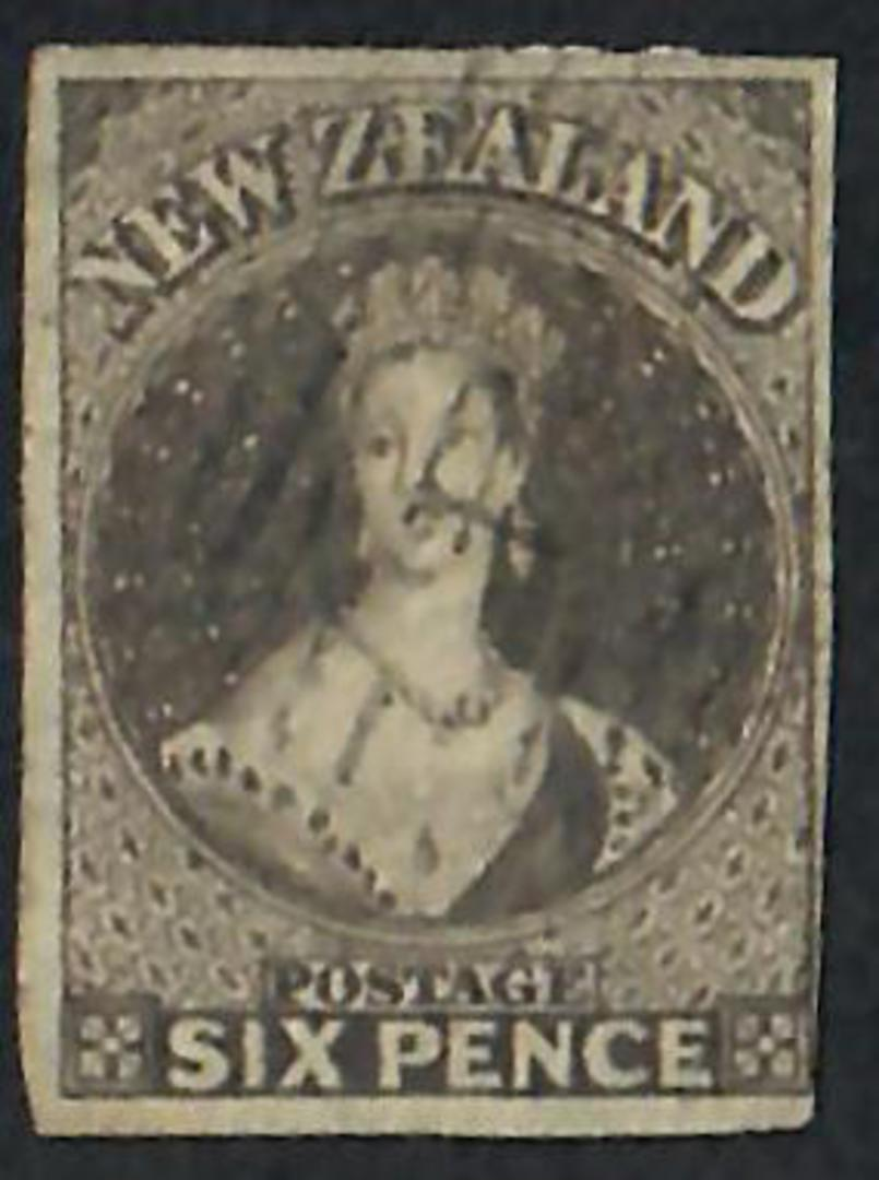 NEW ZEALAND 1855 Full Face Queen 6d Black-Brown.  Imperf. Appears to have roulettes at top. Almost 4 complete margins-just touch image 0