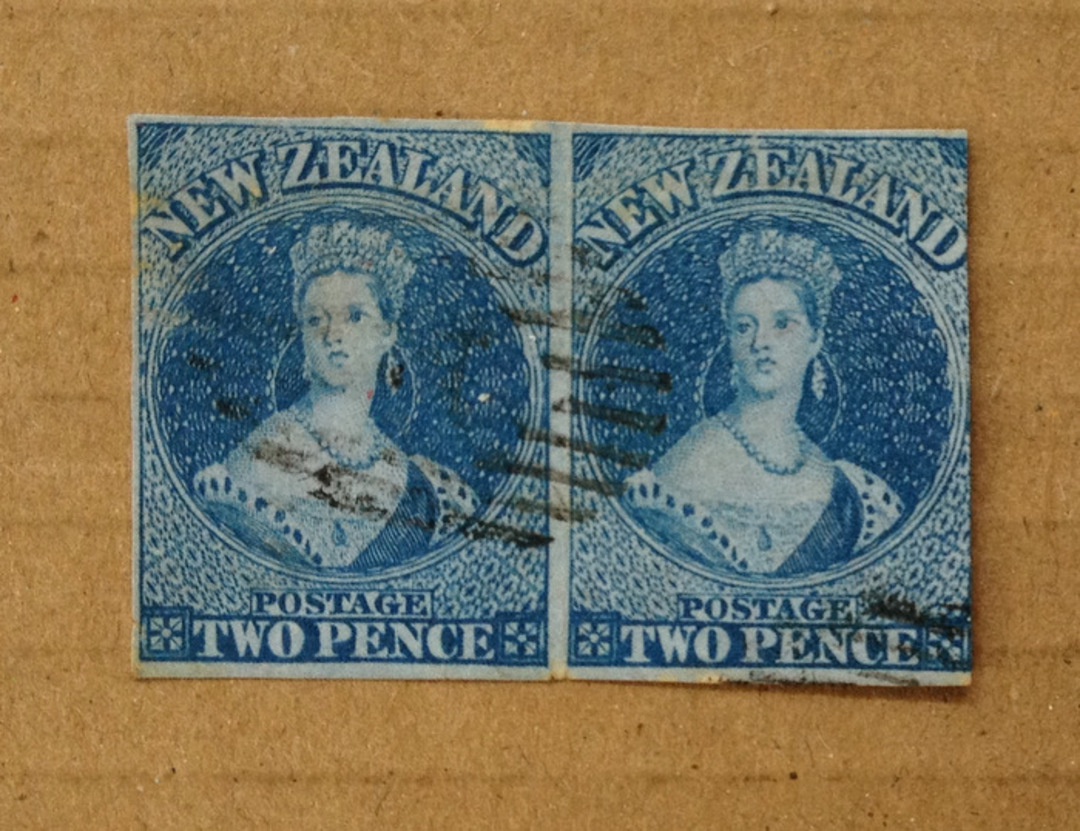 NEW ZEALAND 1855 Full Face Queen 2d Blue on blue. Imperf. Pair (one with full margins. Light cancel off face. Excellent item. - image 0