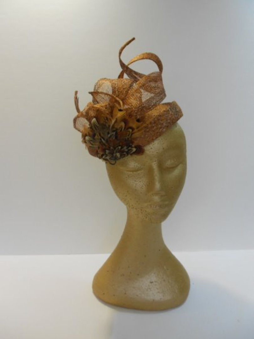 Tan half hat with twirls image 0