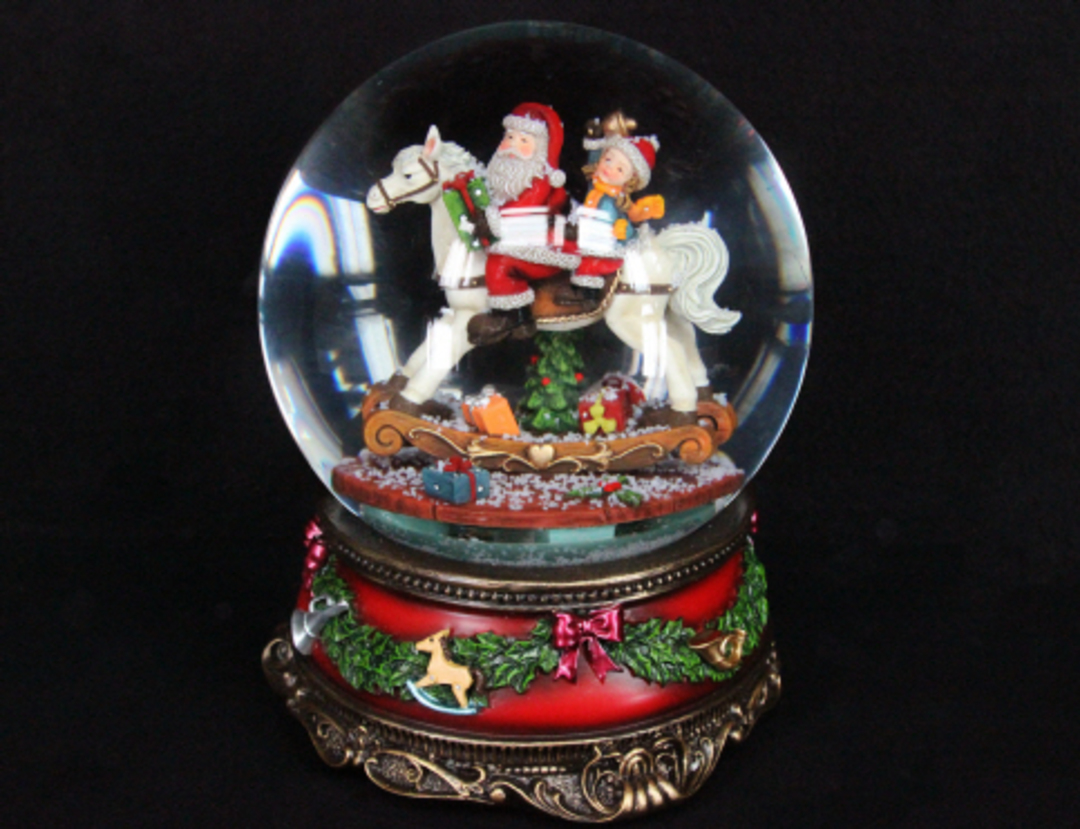 Musical Revolving SnowGlobe Santa and Rocking Horse image 0